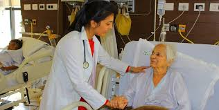 Image showing the caring of old cardiac patient by the doctor